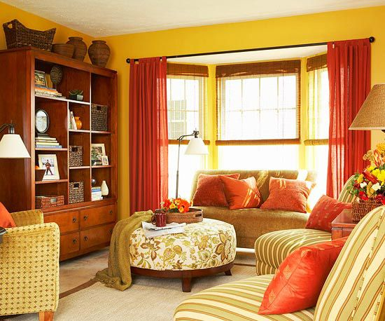 Matching your throw pillows to your window treatments ties everything together.: Rooms Layout, Living Rooms, Warm Color, Yellow Wall, Color Schemes, The Bays, Families Rooms, Rustic Color, Bays Window