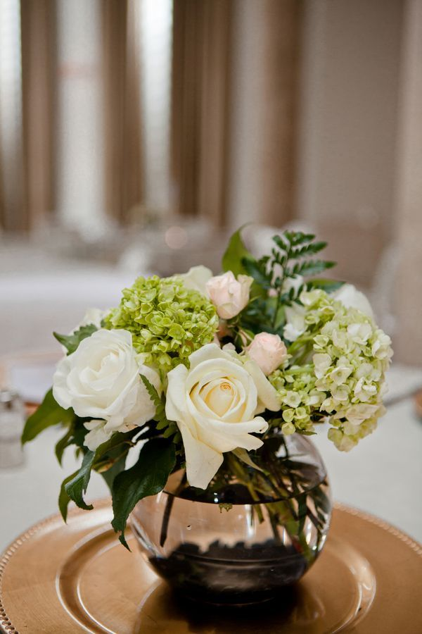 Such a classic centerpiece made out of white roses
