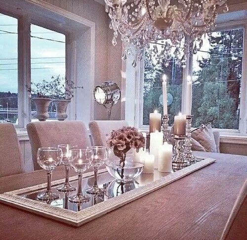 Pink glow dining room with reframed floor mirror as runner