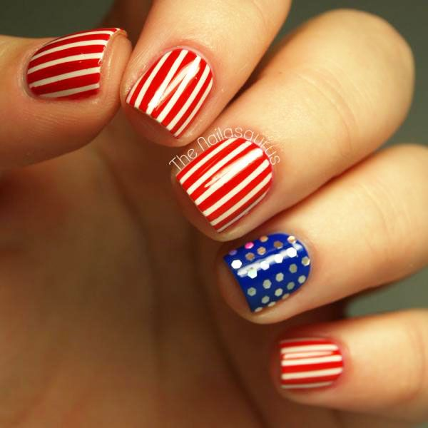 With a little red, white, and blue polish, some striping tape, and some (always necessary) glitter, you can recreate this stars and stripes nail art for the 4th of July! #IndependenceDay #patrioticnails #nailart