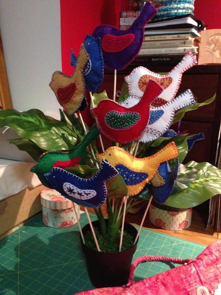 Enhance the garden with embroidered felt birds on sticks.