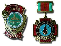 Soviet military badge (left) and medal awarded to liquidators