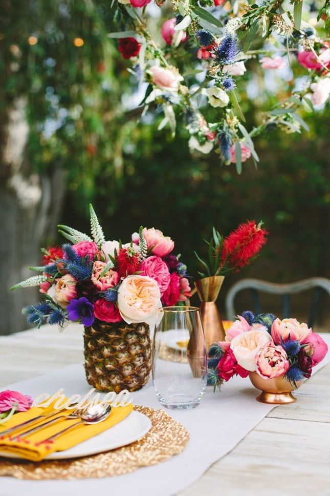 Turn your favorite tropical fruit into a vase at the reception.