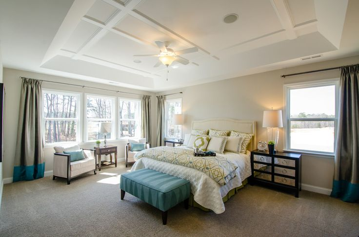Love the raised ceiling in this master bedroom