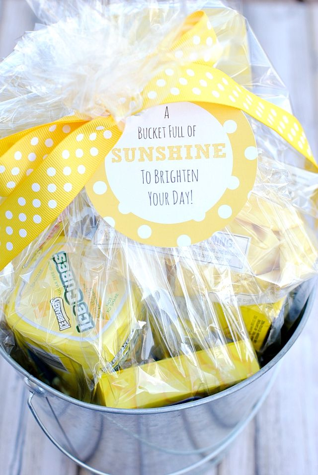 Fun gift idea to brighten a friend's day when they are feeling down. Bucket full of sunshine with free printable tag.