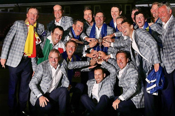The victorious European team celebrate with the Ryder Cup