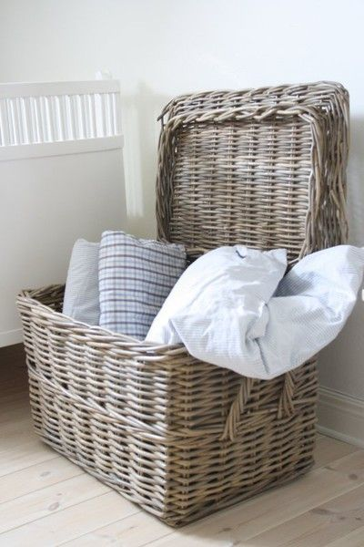 Store throw pillows, throws, magazines, etc... in large wicker baskets with lids.