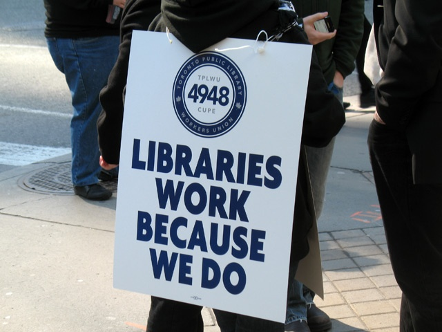 Library workers face a strike/lockout this weekend. This is a photo of supporters of CUPE Local 4948 outside the Toronto Reference Library at Yonge/Bloor.