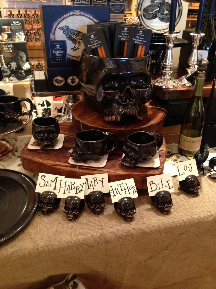 Halloween table at Williams Sonoma. Punch bowl, mugs, place card holders