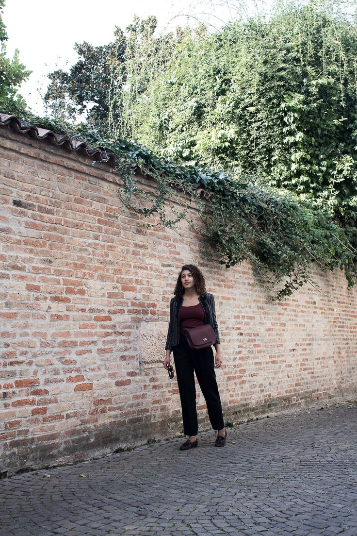 Navigating This by Skyler MApes   San Francisco based style and travel blog   Burgundy accessories for Fall   Burgundy bag, shoes, and black slacks   Travel Treviso, Italy