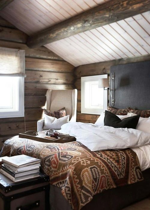 Cosy bedroom with timber and dark wall. Love the bedspread!