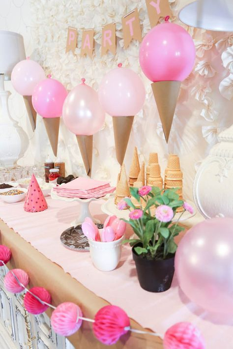 Pink Ice Cream Party Idea - Love this cute set up! Those ice cream cone balloons are awesome! - http://www.classyclutter.net