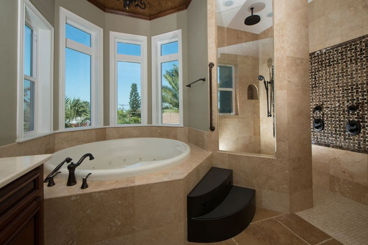 Mediterranean Master Bathroom with Frameless Shower Doors By Dulles Glass and Mirror, Slate Antalya, Travertine