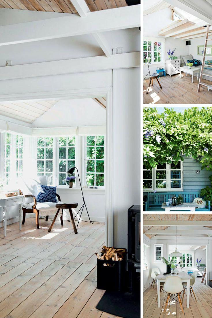 Gemütliches holzhaus in dänemark mit klassischen holz sprossenfenstern