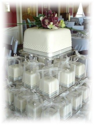 Love the idea of a small Wedding Cake then pass out Individual Wedding Cakes guests can eat or take home! From ALLISON RATCLIFFE Cakemaker