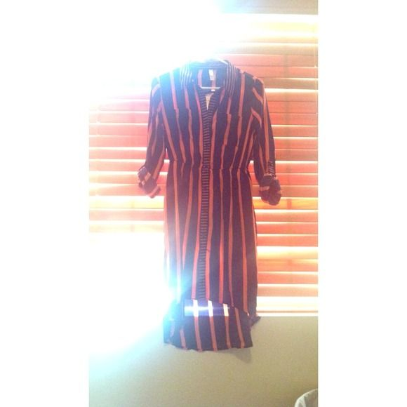 Hi-low Shirt dress w/ roll up sleeves Navy and pink striped hi-low shirt dress with buttons all down the front and cut out back. This dress is soft, silky and super cute. Great for work or play. NWOT Xhilaration Dresses