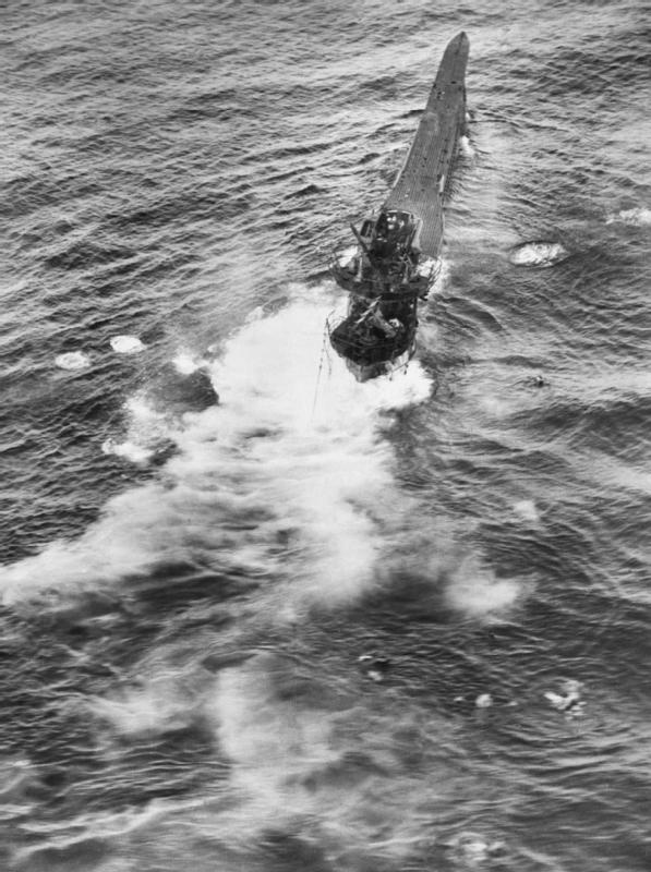 Oblique aerial photograph taken from Short Sunderland Mark III, EK586 'U', of No. 10 Squadron RAAF during an attack on German type VIIC submarine U-426 in the Bay of Biscay. The U-boat is down by the stern and sinking after six depth charges straddled her stern. The captain of EK586, Flying Officer J P Roberts RAAF, was awarded an immediate DFC on his return to Mount Batten, Devon.