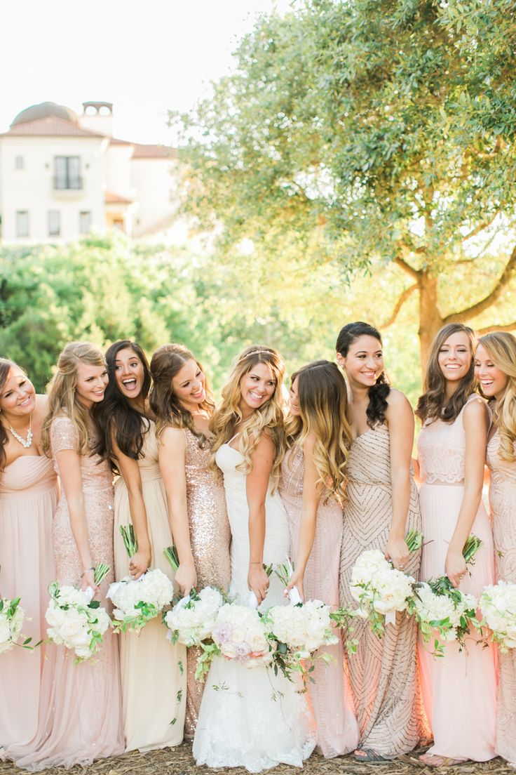 Glittery neutral + blush: http://www.stylemepretty.com//2015/07/27/mix-n-match-bridesmaids-dresses-youll-love/