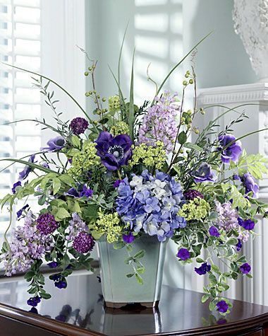 """Let your room overflow with  Hydrangea & Lilac Centerpiece  Item Number: FLB389-PU  Price $229.00  (1 review)  Read 1 ReviewWrite a Review  22""""H x 22""""W  Glorious Hydrangeas & Anemones"""