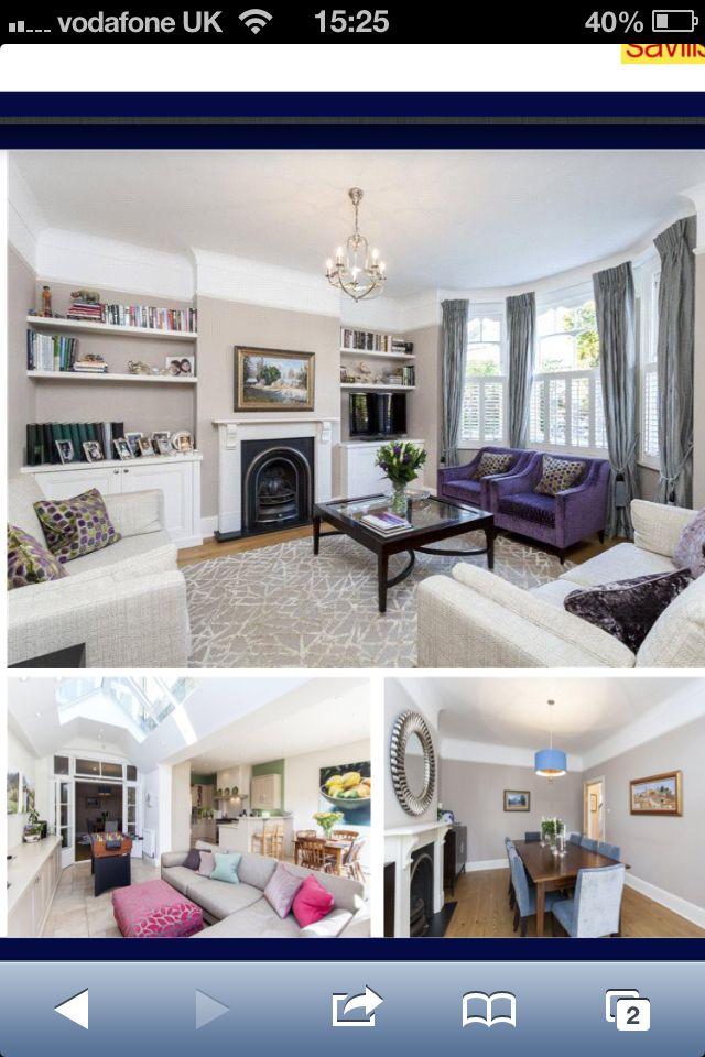 Edwardian reception room- deep sofa, shelving in alcoves, wooden flooring