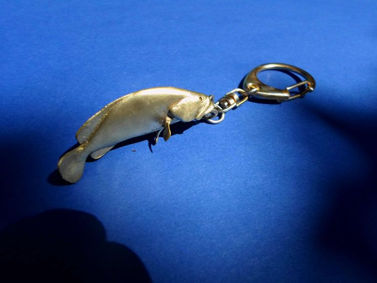 """Epinephelus marginatus"" rufus fish keychain bronze hand carved using the lost wax method. Size: 50mm/1.97 inch high Width: 20mm/0.78 inches"