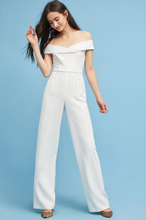 Bridal jumpsuit w/ a sophisticated neckline and pant pockets from anthropologie   #receptiondress #weddingdress #weddingdressinspo #weddingdressinspiration #bridalfashion #bridalstyle #bridaldress #receptioninspo #reception #weddingreception #weddingreceptioninspo #weddingreceptioninspiration #fashion #dress #style #wedding