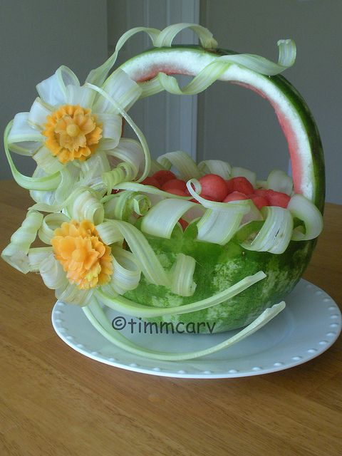 Celery Ribbon Basket    A watermelon fruit basket carving decorate with celery, carrot flowers garinsh on the front.