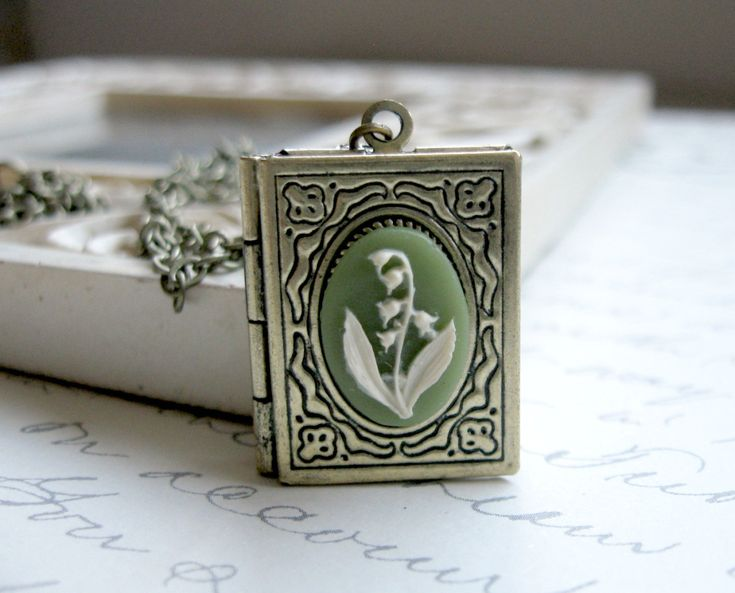 Lily of the Valley Necklace $24  www.etsy.com/listing/128725887/lily-of-the-valley-necklace-book-locket  #spring #spring necklace #nature necklace # lily of the valley