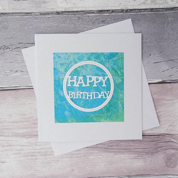 This handmade modern birthday card features a marbled aqua blue and team square topped with a pure white sentiment that reads: Happy Birthday.  This card is one of the most luxurious in my range, with a weight of 380 gsm with a 150 gsm weight envelope.  Please note that due to the unique pattern on the paper, each card will appear very slightly different with different shades of the colours marbled throughout. I sell a range of cards with silhouettes and various messages, these are all…