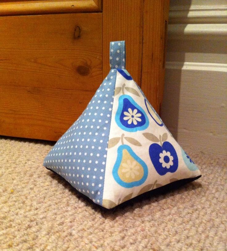 Pyramid door stop - sewn using this tutorial: https://bakeandsew.wordpress.com/2009/02/27/pyramid-doorstop-tutorial/