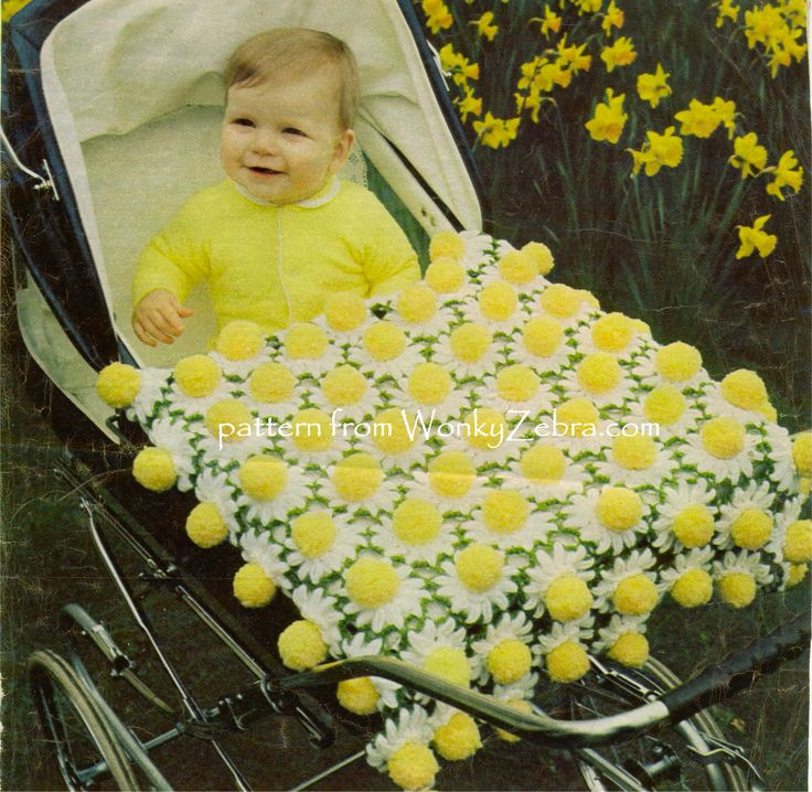 WZ678 An adorable crochet and pompom blanket to make with this easy pattern. Alternative colours are suggested but this daisy/Easter combination is so sweet. from WonkyZebra.com