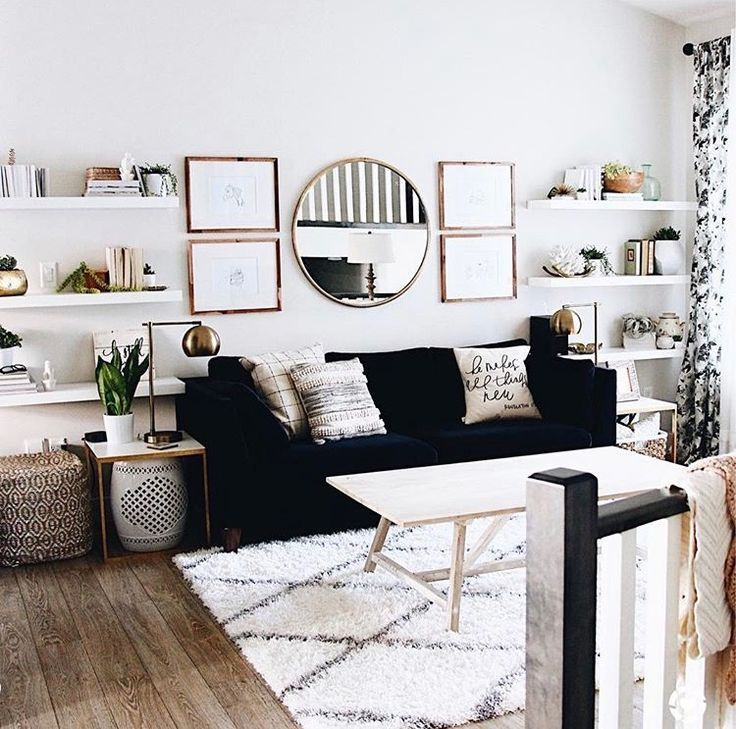 Round shelf with ledges on both sides above couch …