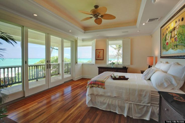 The main house has hot tubs in both of the master bedrooms and a view of the beach -- which is only steps away. Description from…