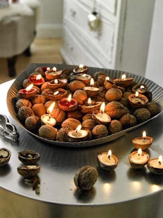 Des bougies dans des coquilles de noix