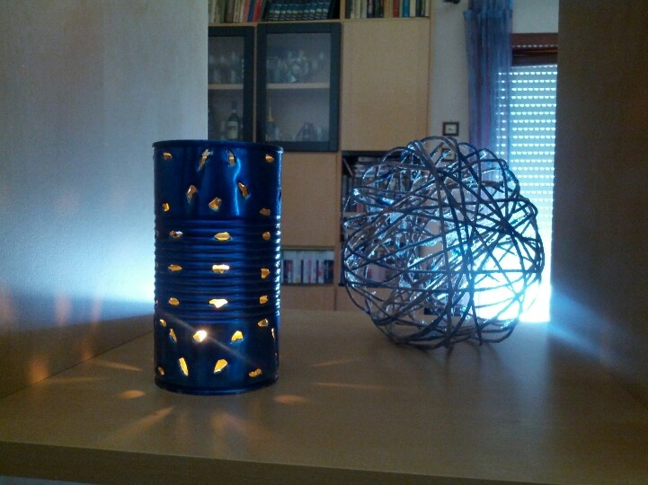 Can with candle inside + Sphere of Twine by Patrizia Zardi