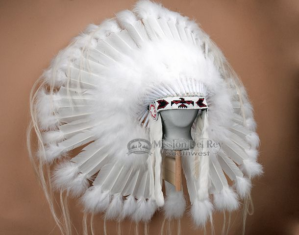 This is an authentic Native American Navajo headdress. This decorative halo war bonnet style head dress is beautifully hand made with real feathers and bead work. Warbonnets are one of the more popula