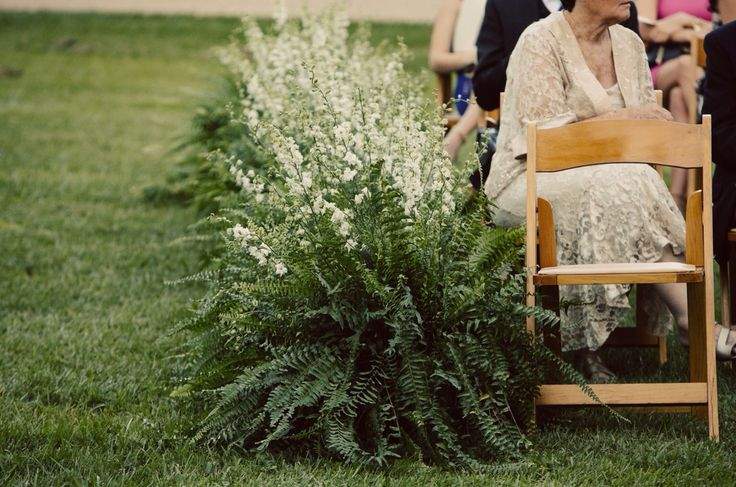 Outdoor Wedding Isle marker of fern and white larkspur