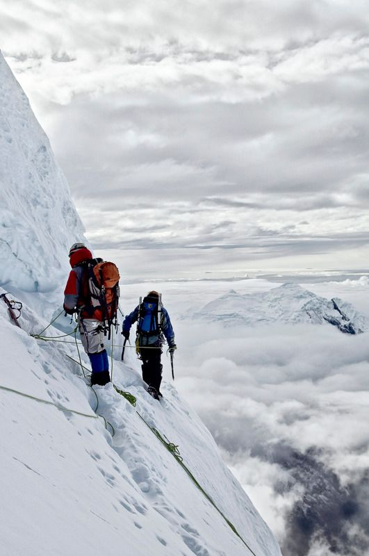 Clearing the crux of Chopicalqui's route... or walking into the clouds.  by Alexandre Buisse