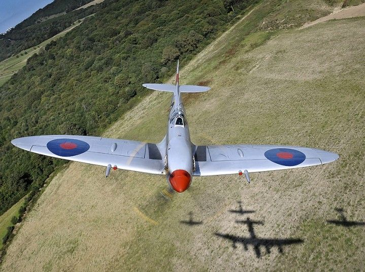 Spitfire MK356 of the Royal Air Force Memorial Flight banks over the tree-line over the shadows of the other aircraft in formation (two other Spifires and a Lancaster). Image taken from the rear-turret of the Lancaster.   Picture: SAC Graham Taylor