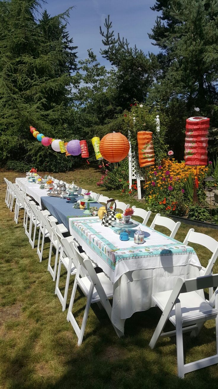 The grand Disney Alice in Wonderland bridal shower party mad tea table! Chinese lanterns from Amazon, rented tables and chairs, a pool of me and my mom's tablecloths and cake stands, teapots and teacups filled with flowers.