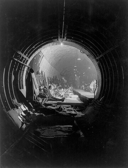 Looking down a subway tunnel which has been converted into an air raid shelter. West End, London, 1940-1941. S)