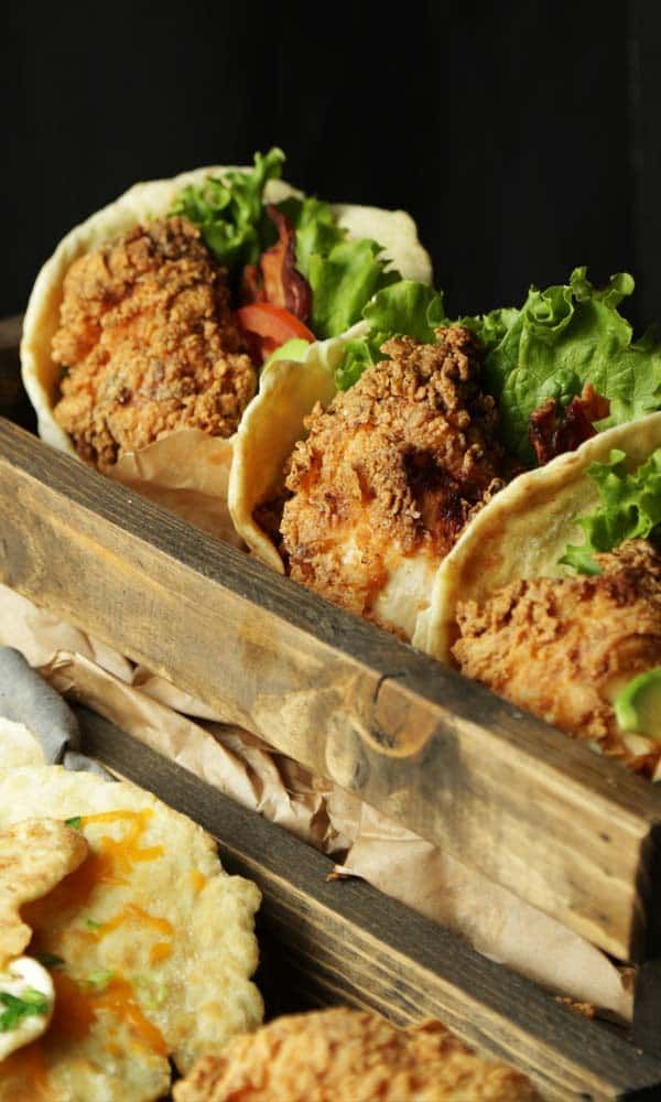 Make this super star one of a kind Fried Chicken and Cheddar Scallion Naan Bread Sandwich recipe.