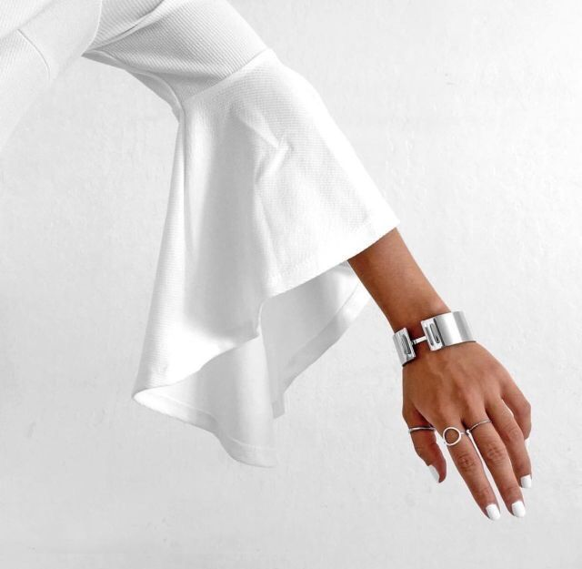 White bell sleeves with minimal silver bracelet