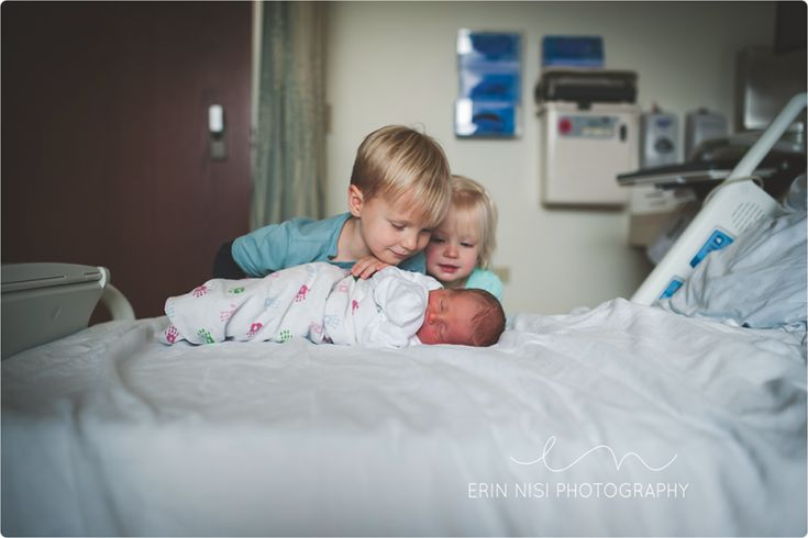 Siblings meeting baby for the 1st time