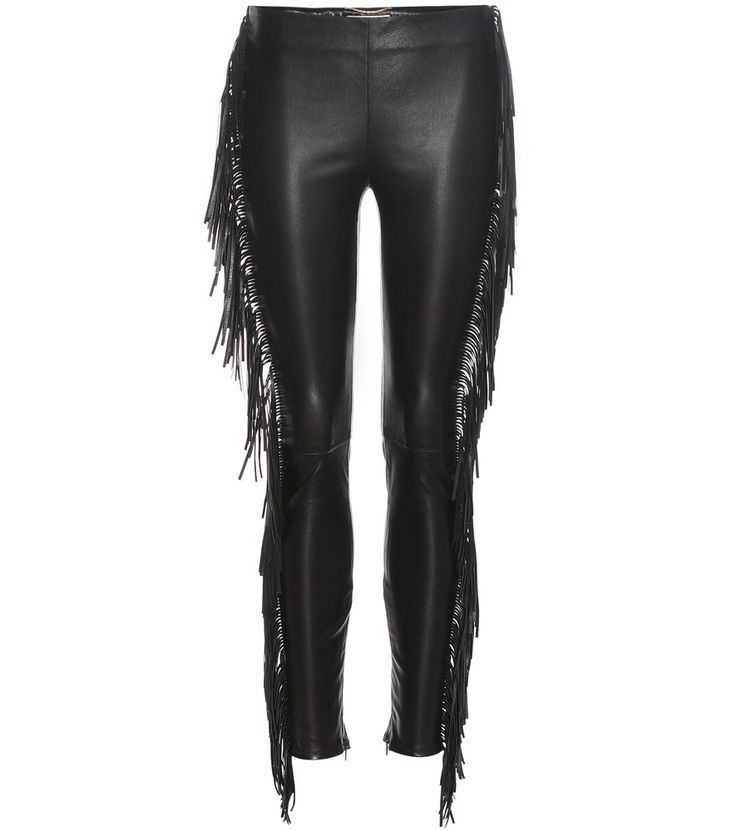 Saint Laurent - Fringed leather trousers - Saint Laurent proves to be the go-to label when it comes to tough-luxe attitude with this statement-making pair of trousers. The skin-tight pair is crafted from sheeny lambskin with bold fringe lining the sides of the legs for playful movement. Style yours with a pair of ankle boots to complement the slightly cropped length. seen @ www.mytheresa.com