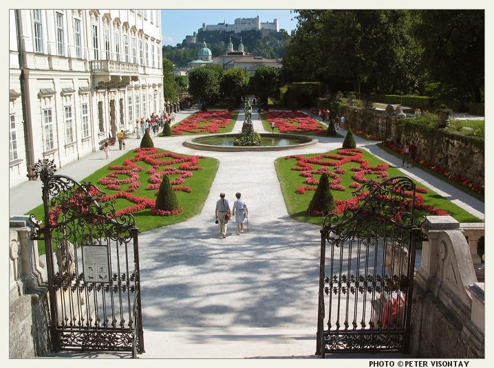 The gardens of Mirabell Palace (Schloss Mirabell) in Salzburg, with the Salzburg Fortress in the background.(Salzburg, Austria)