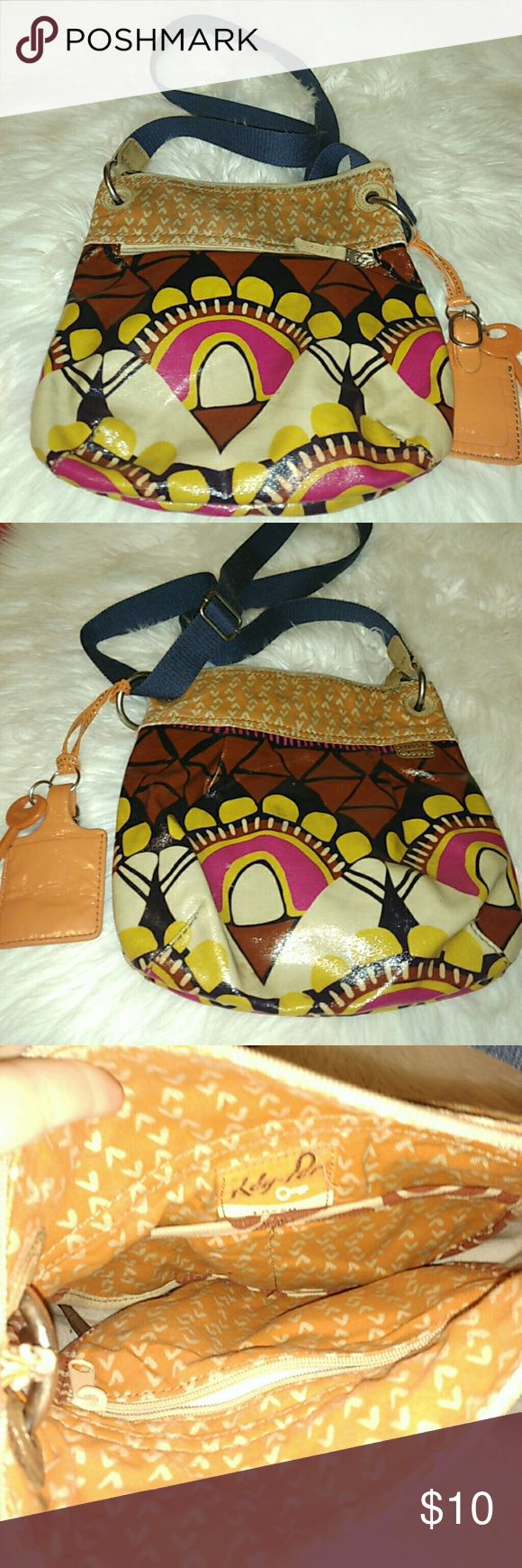 Fossil purse Thus fossil purse has staining ! Still a great purse ! Fossil Bags Shoulder Bags