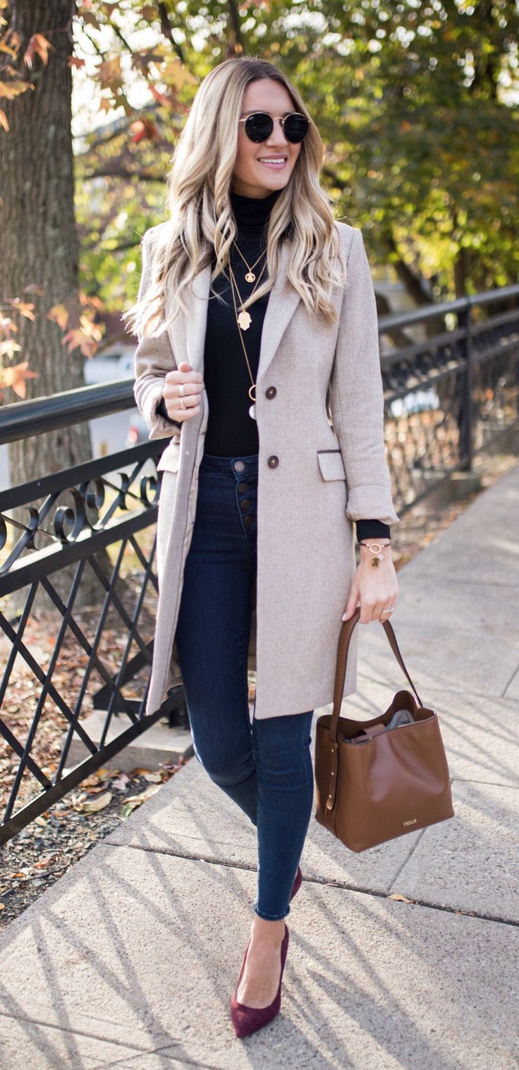 #fall #outfits woman's brown notch-lapel coat, brown leather handbag, black sunglasses, blue skinny jeans, black turtleneck shirt and pair of red bow accent flat shoes. Click To Shop This Look.