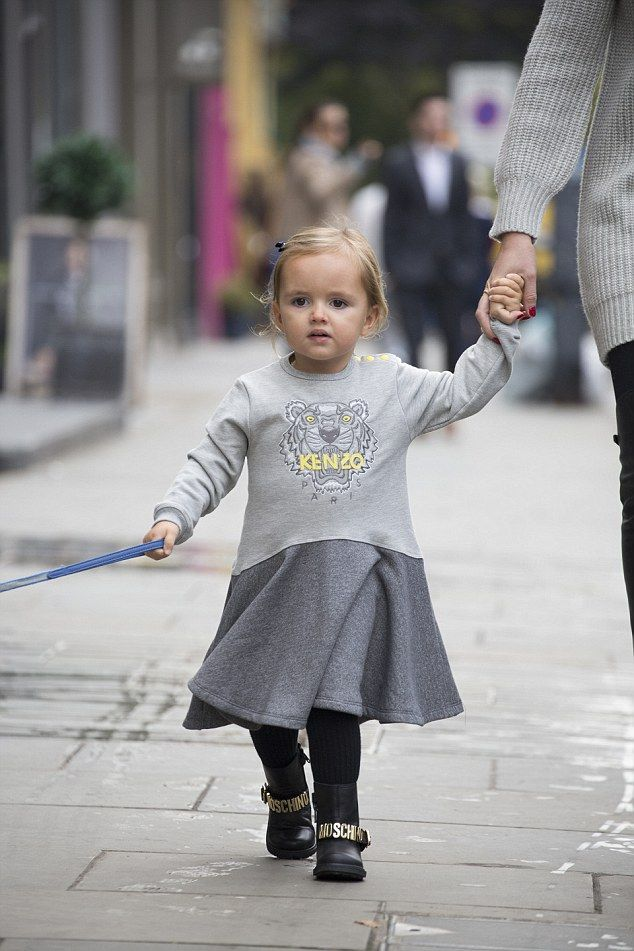 Kenz-OH!The adorable tot looked incredibly trendy in the mullet hemmed grey dress adorned with the instantly recognisable Kenzo tiger logo