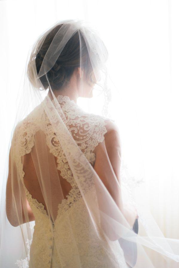 Lace high neckline wedding dress: http://www.stylemepretty.com/2014/02/24/sioux-falls-south-dakota-wedding-at-steever-house-bed-breakfast/ Photography: Jeff Sampson - http://www.jeffreysampson.com/